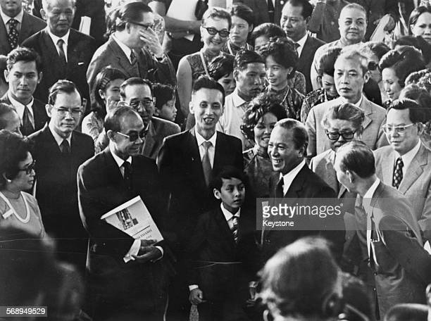 South Vietnamese President Nguyen Van Thieu smiling in the middle of a crowd of people as he opens a new hospital in Saigon March 22nd 1973