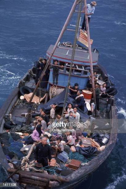 South Vietnamese refugees approach a US war ship to seek refuge from the invading force from the North April 1975 in the South China Sea near Saigon...