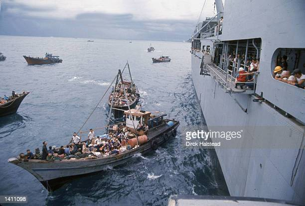 South Vietnamese refugees in boats approach a US war ship to seek refuge from the invading force from the North April 1975 in the South China Sea...
