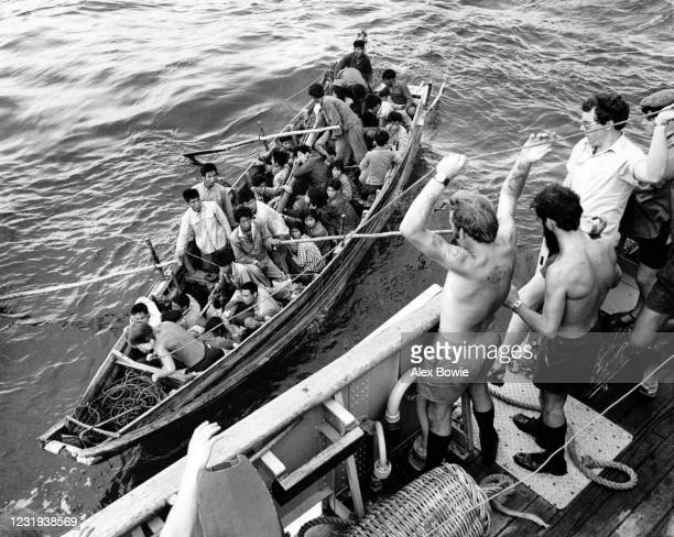 South Vietnamese refugees – known as boat people – approach a British Royal Fleet Auxiliary ship for sanctuary after fleeing South Vietnam, South...