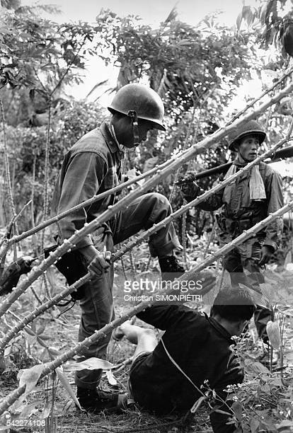 South Vietnamese soldiers crossexamine a Vietcong fighter during a search operation for missing French journalist Michele Ray who was kidnapped by...