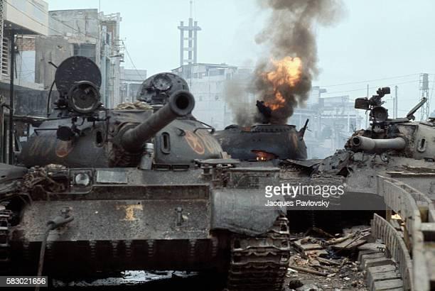 South Vietnamese tank in flames as North Vietnamese forces enter Saigon