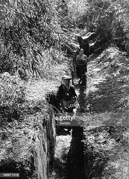South Vietnamese villagers Communist guerrillas carrying grenades in a trench Viet Cong Vietnam War 1966