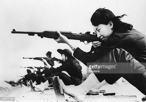 South Vietnamese women at shooting practice on a rifle range August 1962 The women are recruits to the South Vietnamese government's new civil...