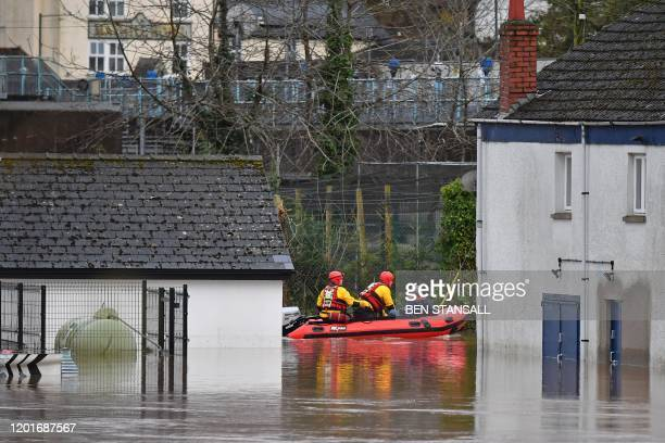 South Wales Fire and Rescue take a resident through floodwaters in Monmouth south Wales on February 18 after Storm Dennis caused flooding across...