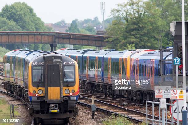 A South Western Railway passenger train operated by Firstgroup Plc departs from Guildford UK on Monday June 11 2018 FirstGroup Plc the unprofitable...