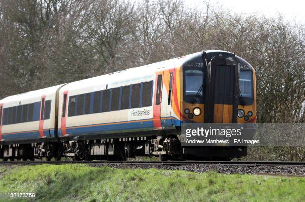 South Western Railway train makes it's way along the line near to Basingstoke in Hampshire.