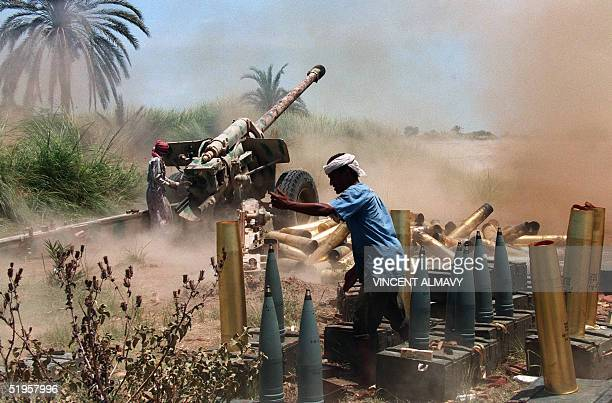 A south Yemeni soldier fires a 130mm gun towards northern Yemeni forces as fighting goes on since threeweeks in Yemen's civil war AFP PHOTO VINCENT...