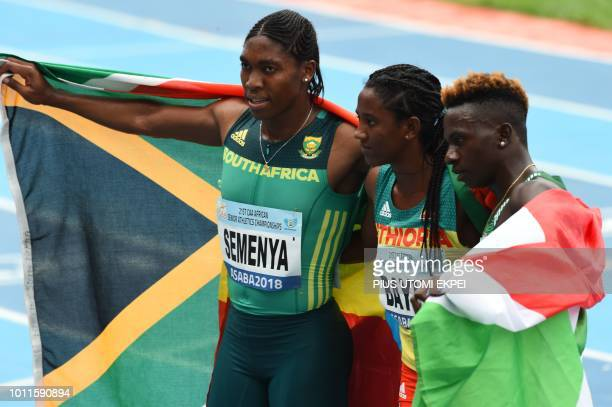 SouthAfrica gold medalist Caster Semenya pose with Ethiopia bronze medalist Bayih Alemu and silver Burundi Francine Niyonsaba after the women's 800m...
