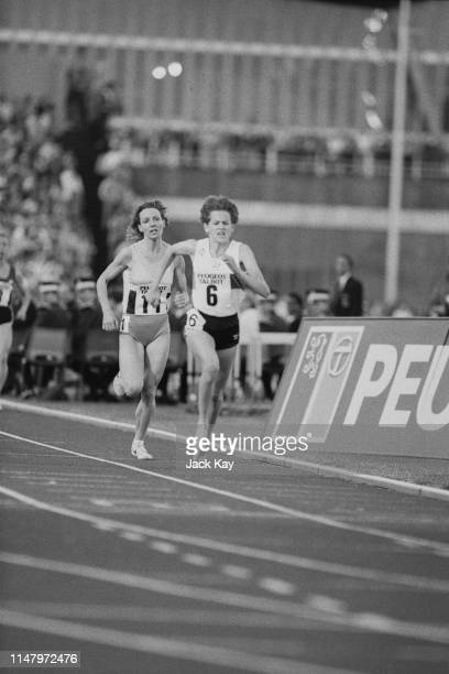 South-African middle-distance and long-distance runner Zola Budd running barefoot on her way to a women's 2000 metres world record time of 5 minutes...