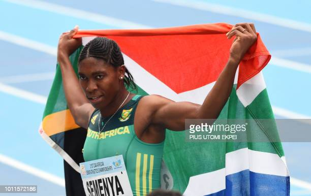 SouthAfrica's Caster Semenya celebrates with her national flag after winning the women's 800m of the African Athletics Championships at the Stephen...