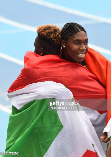 SouthAfrica's Caster Semenya hugs Burundi's scond placed Francine Niyonsaba after winning the women's 800m of the African Athletics Championships at...