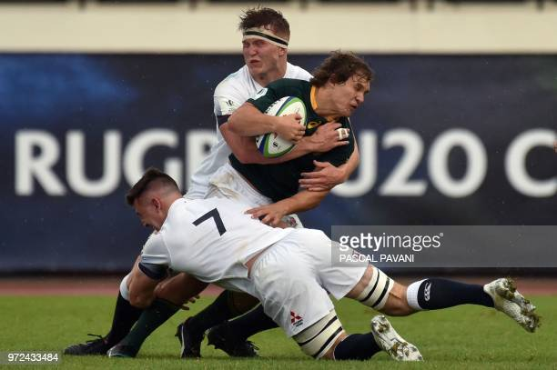SouthAfrica's flyhalf David Coetzer vies with England's lock Ted Hill and flanker Ben Curry during the U20 World Rugby union Championship semifinal...