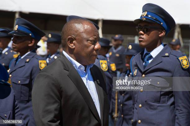 SouthAfrica's President Cyril Ramaphosa inspects an honour guard of South African Police Services members as he came to attend the launch of the new...