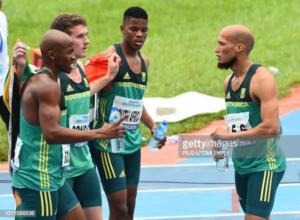 SouthAfrica's team celebrate their second place in the men's 4x400m relay of the African Athletics Championships at the Stephen Keshi Stadium in...