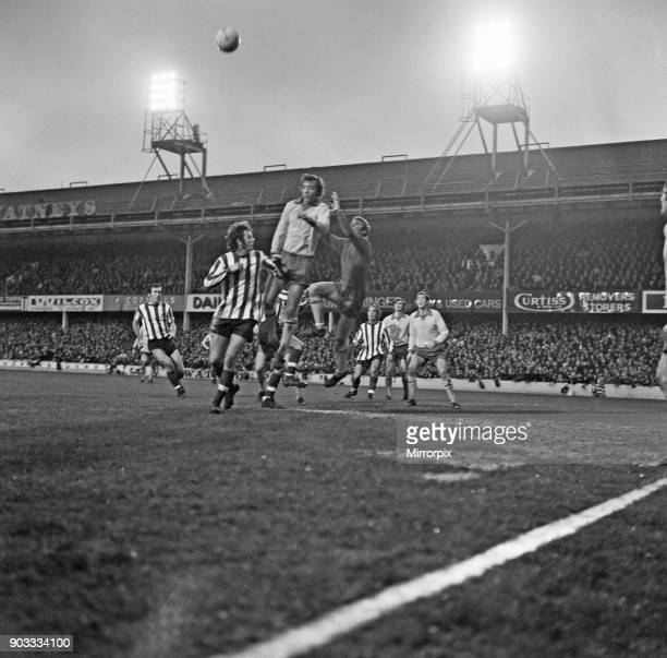 Southampton 2 -5 Manchester United, League Division One match. David Sadler of Manchester United heads clear from Mike Channon with United goalkeeper...