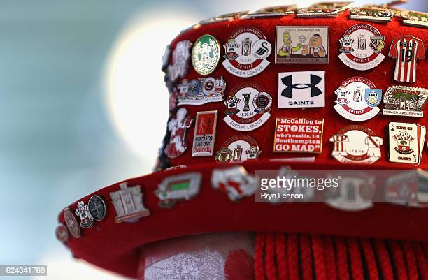 Southampton badges are seen on a Southampton fans hat prior to kick off during the Premier League match between Southampton and Liverpool at St...