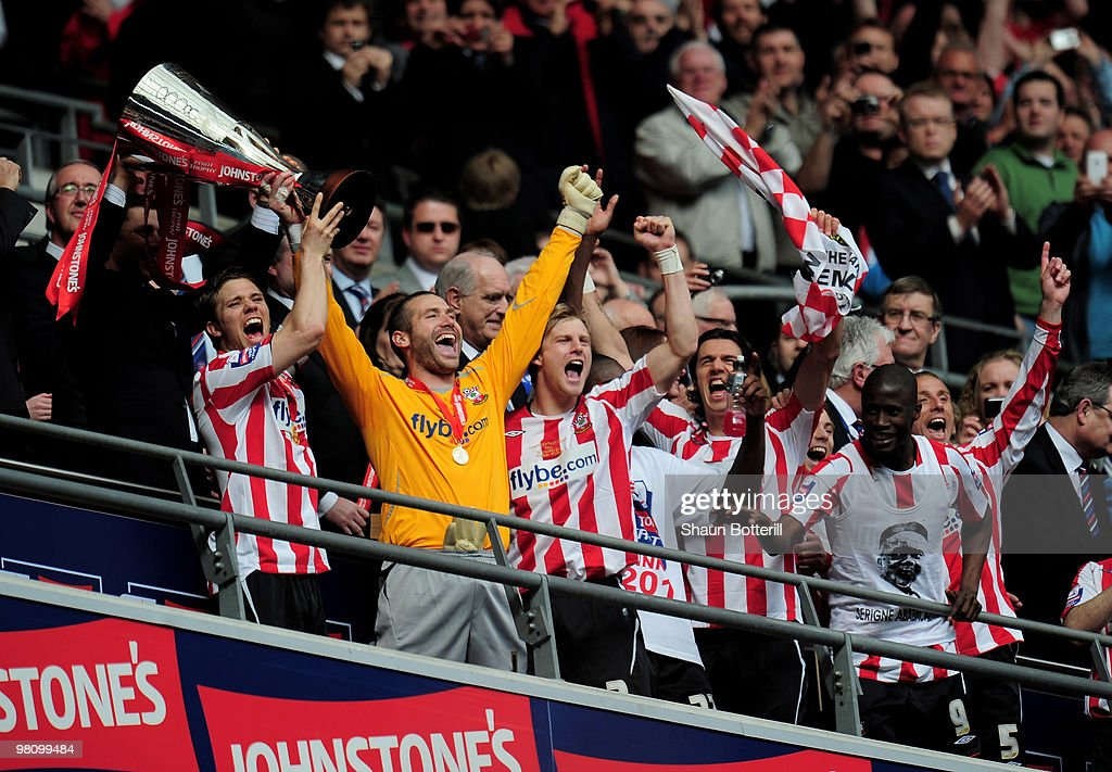 Southampton captain Dean Hammond and goalkeeper Kelvin Davis lift the trophy after winning the Johnstone's Paint Trophy Final between Southampton and Carlisle United at Wembley Stadium on March 28, 2010 in London, England.