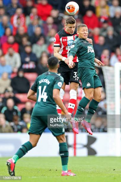 Southampton defender Jan Bednarek out jumps Newcastle forward Dwight Gayle during the Premier League match between Southampton and Newcastle United...