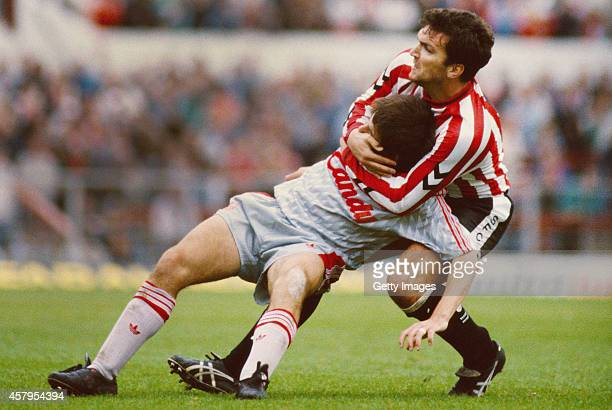 Southampton defender Neil 'Razor' Ruddock gets to grips with Liverpool player Peter Beardsley during a Division One match between Southampton and...