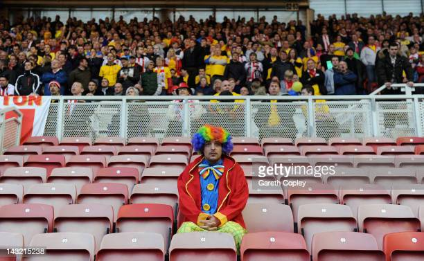 Southampton fan dressed as a clown watches the npower Championship between Middlesbrough and Southampton at Riverside Stadium on April 21, 2012 in...