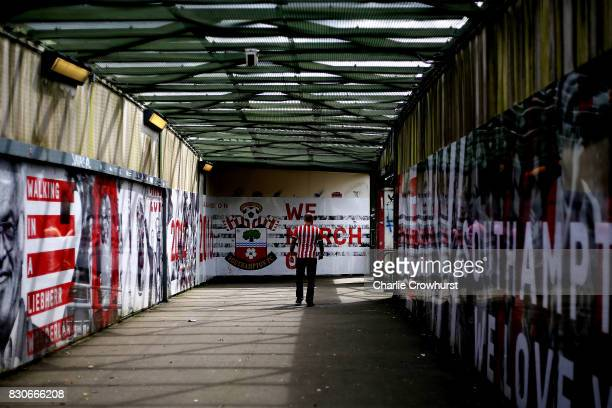 Southampton fan makes his way to the stadium prior to the Premier League match between Southampton and Swansea City at St Mary's Stadium on August 12...