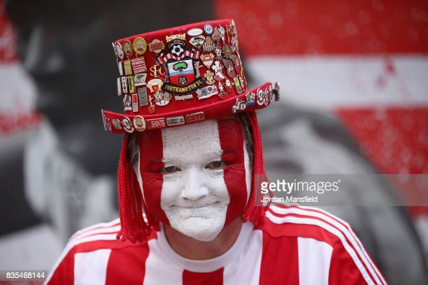 Southampton fan poses for a photograph prior to the Premier League match between Southampton and West Ham United at St Mary's Stadium on August 19...
