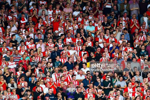 Southampton Fans cheer on their side during the Premier League match between Southampton and Swansea City at St Mary's Stadium on August 12 2017 in...