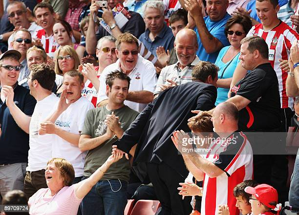 Southampton fans give Matt le Tissier a warm reception during the CocaCola League One match between Southampton and Millwall at St Mary's on August 8...