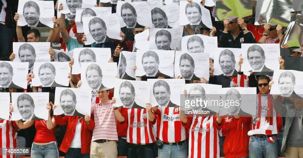 Southampton fans hold up pictures of recently deceased World Cup '66 winner Alan Ball, during the Coca-Cola Championship match between Southampton...
