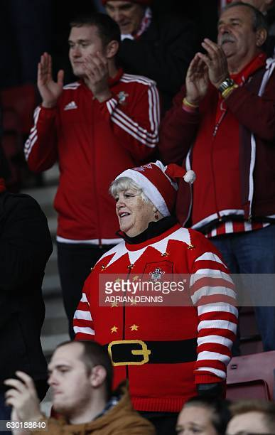 Southampton fans one in a Santa Claus jumper applaud the fans ahead of the English Premier League football match between Bournemouth and Southampton...