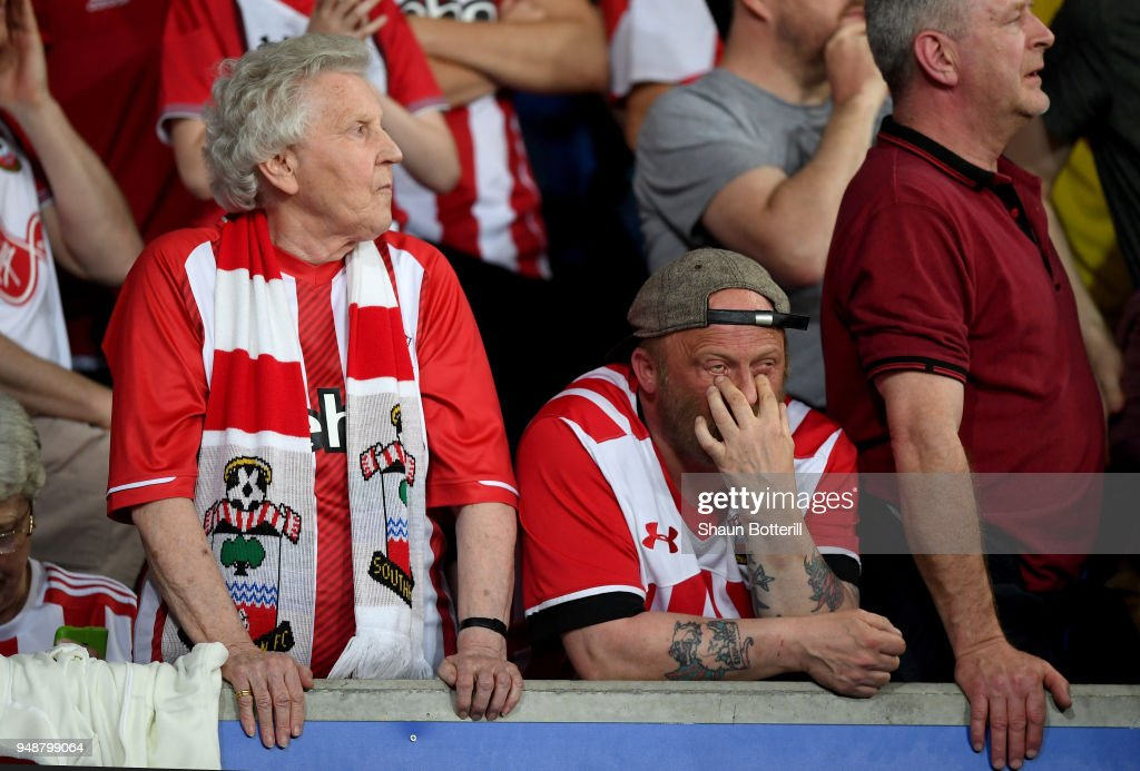 Southampton fans react during the Premier League match between Leicester City and Southampton at The King Power Stadium on April 19, 2018 in Leicester, England.