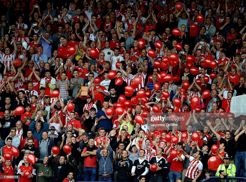 Southampton fans release balloons during the Barclays Premier League match between West Bromwich Albion and Southampton at The Hawthorns on August 17, 2013 in West Bromwich, England.
