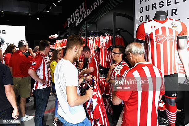 Southampton fans take a look at their new kit inside the club shop at St Mary's Stadium prior to kick off during the Premier League match between...