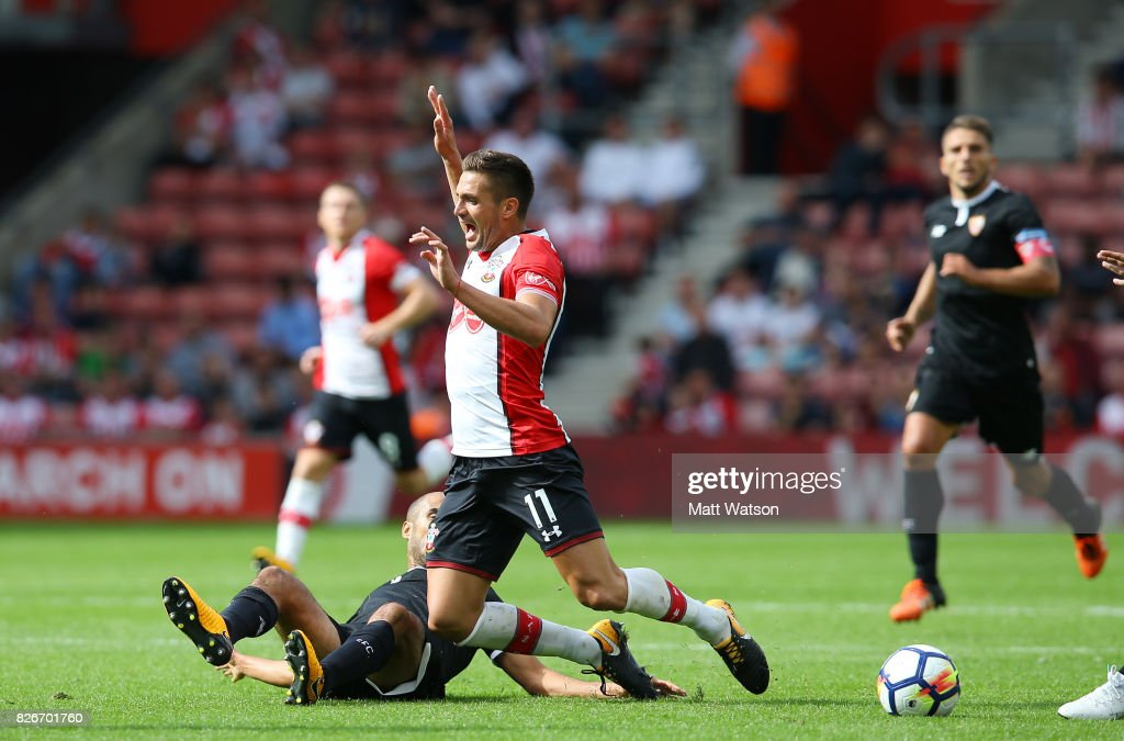 Southampton FC's Dusan Tadic is tackled during the pre-season friendly between Southampton FC and Sevilla at St. Mary's Stadium on August 5, 2017 in Southampton, England.