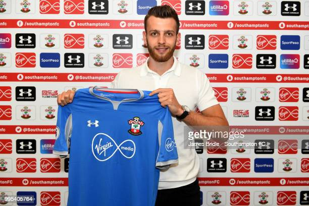 Southampton FC's latest signing goalkeeper Angus Gunn poses with his jersey at Staplewood Training Ground on July 10 2018 in Southampton England