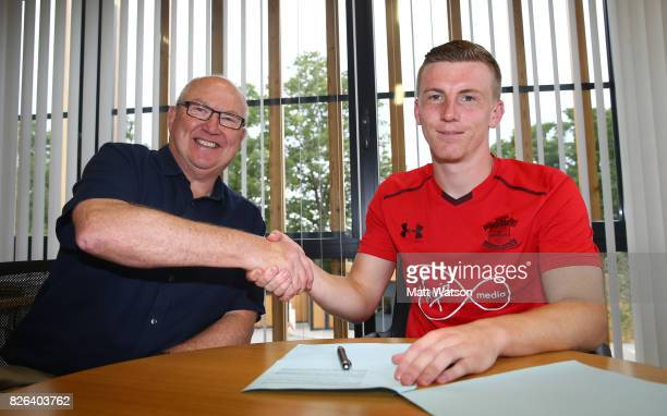 Southampton FC's Matt Targett signs a new five year contract with the club pictured with Vice Chairman Les Reed at the Staplewood Campus on August 4...