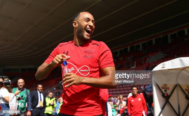 Southampton FC's Nathan Redmond heads out to warm up during the preseason friendly between Southampton FC and Sevilla at St Mary's Stadium on August...