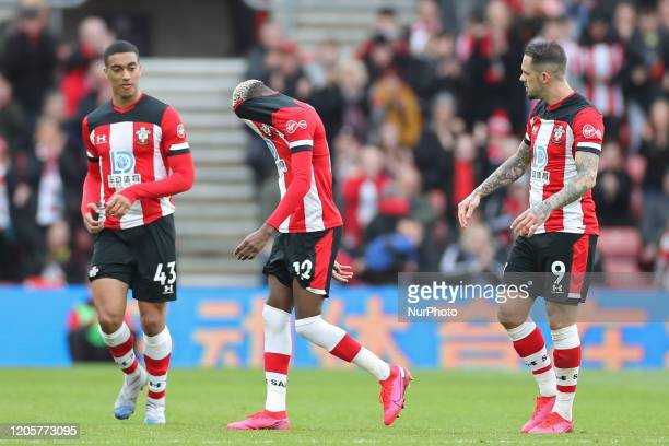 Southampton forward Moussa Djenepo hangs his head in shame after a red card from Referee Graham Scott during the Premier League match between...