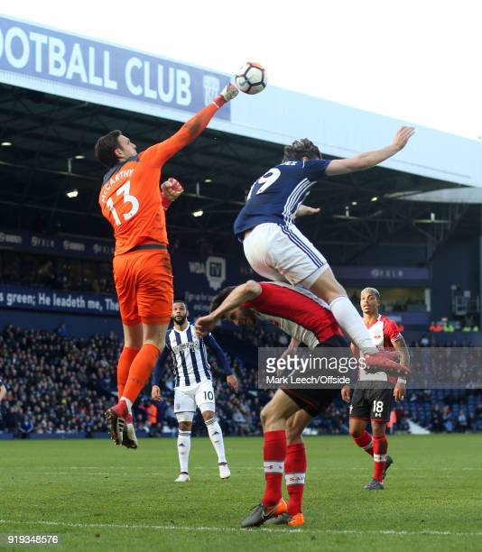 Southampton goalkeeper Alex McCarthy punches the ball clear under pressure from Jay Rodrigues of West Brom during the FA Cup Fifth Round match...