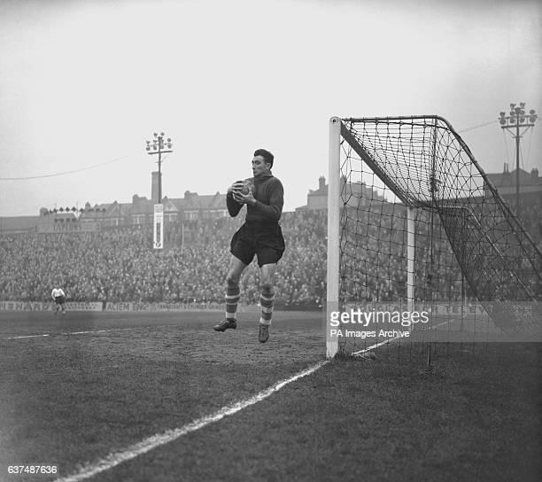 Southampton goalkeeper John Christie safely catches the ball