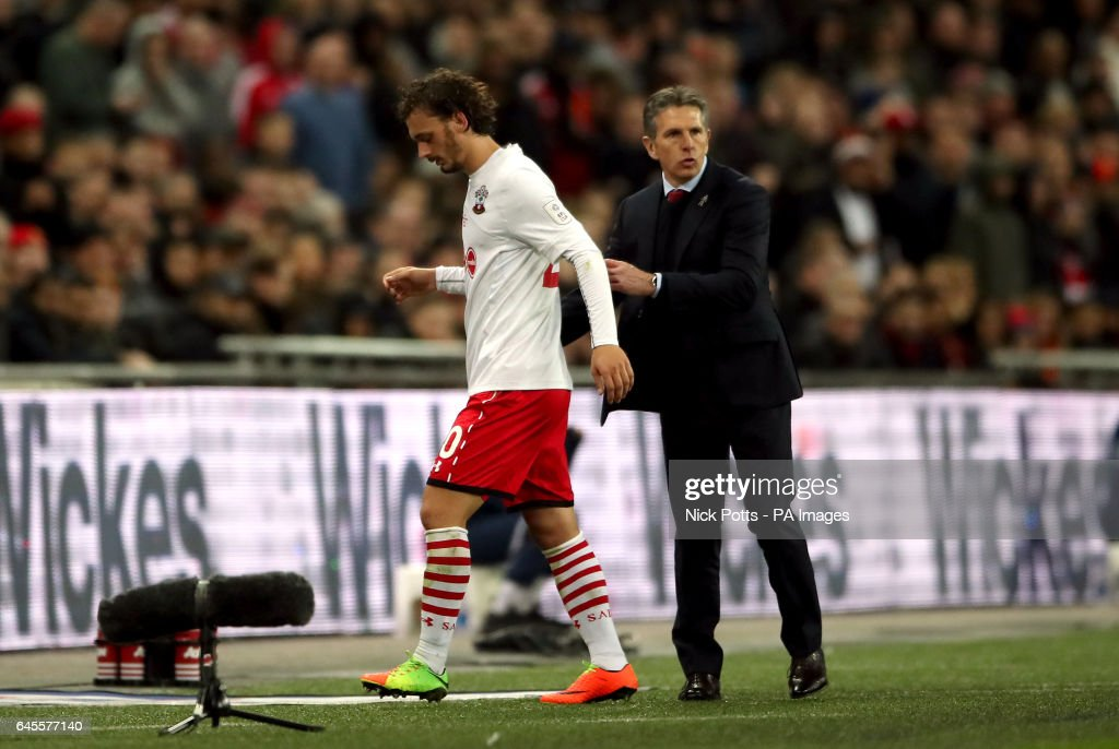 Southampton manager Claude Puel with Manolo Gabbiadini after he is substituted during the EFL Cup Final at Wembley Stadium, London.