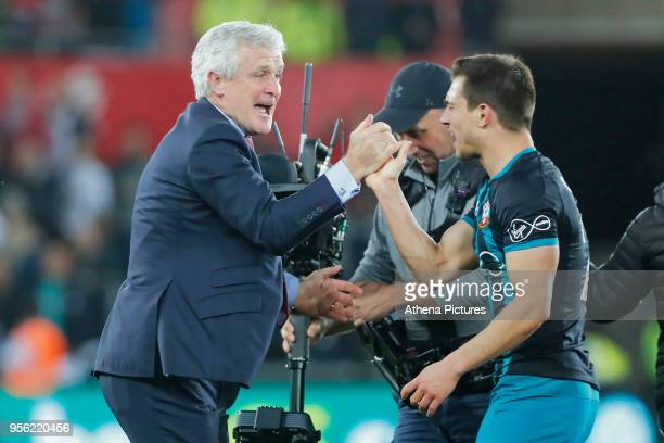 Southampton manager Mark Hughes celebrate his team's win during the Premier League match between Swansea City and Southampton at The Liberty Stadium...