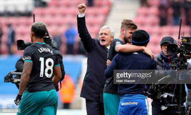Southampton manager Mark Hughes celebrates during the FA Cup Quarter Final match between Wigan Athletic and Southampton FC at the DW Stadium on March...