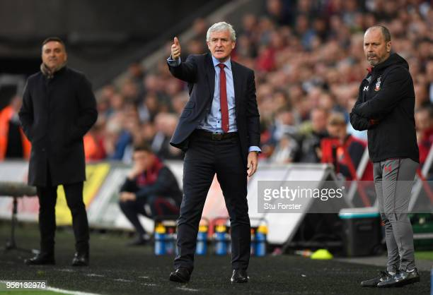 Southampton manager Mark Hughes reacts during the Premier League match between Swansea City and Southampton at Liberty Stadium on May 8 2018 in...