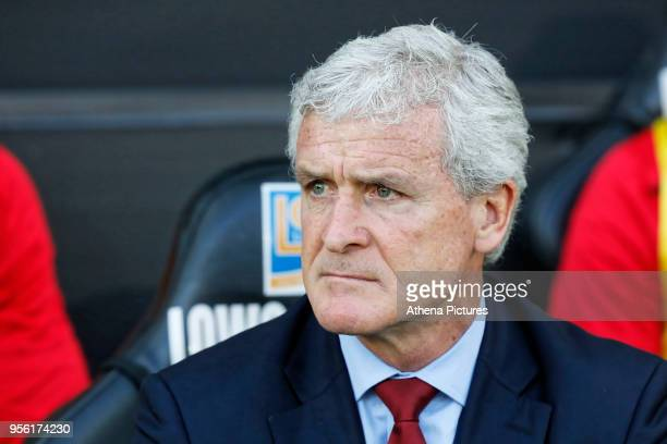 Southampton manager Mark Hughes sits on his bench during the Premier League match between Swansea City and Southampton at The Liberty Stadium on May...