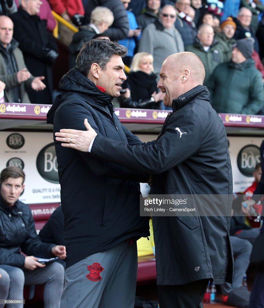 Southampton manager Mauricio Pellegrino (left) is greeted by Burnley manager Sean Dyche ahead of kick-off during the Premier League match between Burnley and Southampton at Turf Moor on February 24, 2018 in Burnley, England.