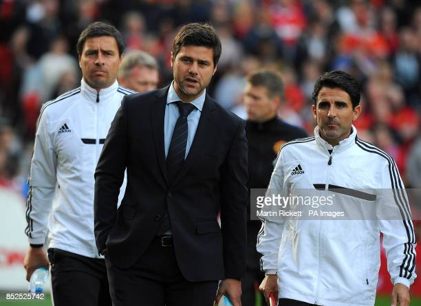 Southampton manager Mauricio Pochettino assistant manager Jesus Perez and first team coach Miguel D'Agostino before kickoff