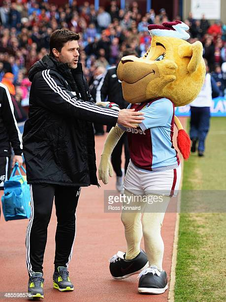 Southampton manager Mauricio Pochettino shares a joke with one of the Aston Villa mascots before the Barclays Premier League match between Aston...