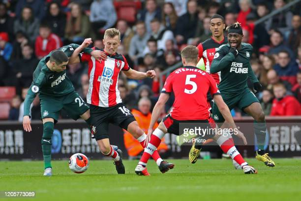 Southampton midfielder James WardProwse jostles with Newcastle midfielder Miguel Almiron during the Premier League match between Southampton and...